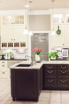 Beautiful white and black kitchen | beadboard | cottage | pendant lights...really liking this kitchen!!! Think I would go gray cabinets though...instead of white! Very classy...