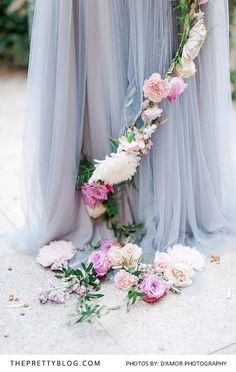 Light blue tulle dress with floral decoration | Dress by Zanne Couture | Photograph by D'Amor Photography |