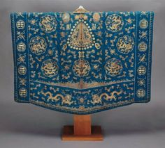 Vestment for 1st degree Daoist priest (hongi)  Chinese, Qing dynasty, late 19th century  DIMENSIONS:Height x width: 55 x 84 in. (139.7 x 213.4cm)  MEDIUM OR TECHNIQUE:Silk damask with couched gold-wrapped threads