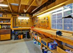 Rustic garage with concrete floors standard height cat flush light exposed Garage Workshop Plans, Workshop Layout, Workshop Design, Garage Workshop Organization, Home Workshop, Garage Plans, Design Loft, Shed Design, Garage Design
