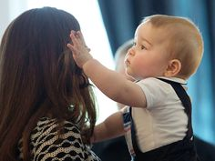 Ever attentive of his mother's perfect hair, George fixed an out-of-place strand.  - GoodHousekeeping.com