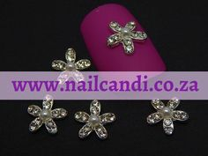"""""""Petal to the Metal"""" 3D Nail Art Jewels available on our website www.nailcandi.co.za The ONLY reusable nail art available! #3DNailArt #NailArtCharms #NailCandy"""