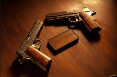 Cabot Guns - Here's a mirror image set of left and right handed 420 stainless steel 1911's.