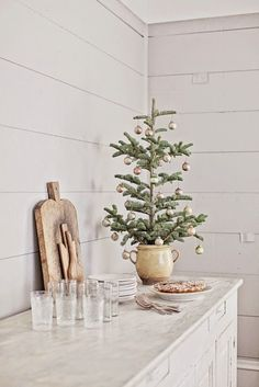 Whimsical Holiday Decor Inspiration, Ideas & Christmas Decorating Finds French farmhouse Christmas tree in a French pot is a vision of whimsical white wintry country French bliss! Tiny Christmas Trees, Cozy Christmas, Simple Christmas, Christmas Tree Decorations, Christmas Holidays, White Christmas, Whimsical Christmas, Natural Christmas, Christmas Images
