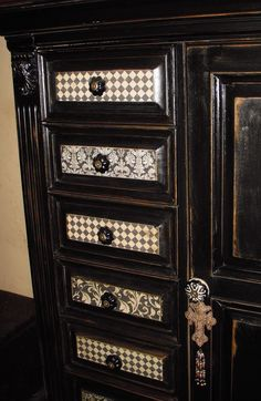 Old cabinet, painted, aged, and added scrap book paper to drawers with Mod Podge.  Awesome!
