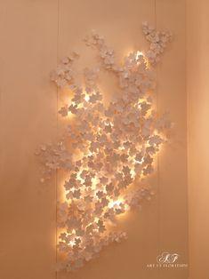 Illuminated vine leaves in white #interiordesign #lighting #crafstmanship #luxury