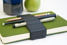 This clever bandolier wraps around your books to keep all your pens, pencils and highlighters
