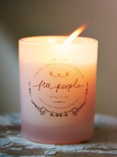 100% of profits goes to Clean Water Fund // Free People Candle   Hand-poured in the USA, our artisan candle features an all-natural soy wax blend, scented with eucalyptus and Siberian pine, for a natural and illuminating fragrance. Beautifully packaged and presented in an opalescent glass jar. Add this signature scent to any space for a refreshing, aromatic accent. Metal lid features etched floral pattern.