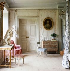 ~red gingham armchair in this elegant Swedish room - Lars Sjoberg