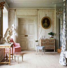 ~red gingham armchair in this elegant Swedish room - Lars Sjoberg