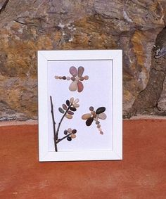 Dragonflies Beach Pebble Picture in White by kormendesigns on Etsy, £28.00