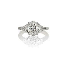 CUSTOM OVAL AND CRESCENT HALF MOON DIAMOND THREE-STONE ENGAGEMENT RING
