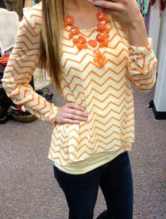 chevron sheer top, cross over back, bubble necklace and skinny jeans. Perfect Spring combo. www.sexymodest.com