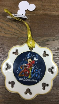 This is the Walt Disney World 2016 Snowflake Christmas Ornament. One side features Minnie Mouse and the other Sorcerer Mickey Mouse. International purchasers are responsible for any customer and/or du Disney Toys, Disney Mickey Mouse, Minnie Mouse, Disney World Trip, Disney Vacations, Disney Ornaments, Christmas Ornaments, Disney World Merchandise, Snowflakes