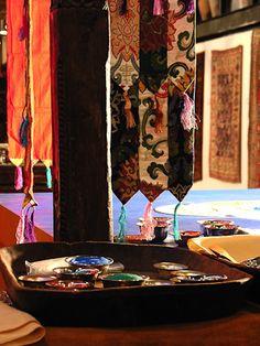 Tibetan silks and mandala sands.