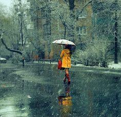 yellow rain jacket on a rainy day