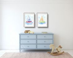 Navy Blue Sailboat Art Print Digital Download. THis nautical nursery wall decor is available as a digital download, giclee or canvas print. There are 3 other matching sailboats to match. #printable #wallart #boysroom #homedecor #nautical