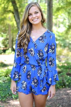 Cobalt blue is definitely a go...especially since all eyes will automatically shift to you! By Blu Pepper, this vibrant romper features a taupe, cream, and brown floral print that is simply to die for