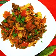 This easy low carb, paleo recipe infuses a medley of ground beef and vegetables with the rich flavors of garlic and taco seasoning.