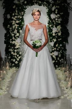 Stunning lace all over this beautiful white wedding gown.