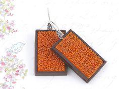 Orange filigree earrings. Polymer clay by Tatiana Korba, via Flickr