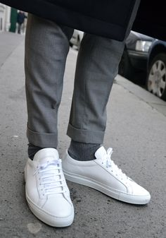 LES FRERES JOACHIM, white trainers with cuffed tailored trousers.