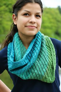 Knit with a luxurious Queen of Hearts Mini Skein Pack, this cowl is fit for royalty. The merino and cashmere blend perfectly defines the stitches and eyelets creating a delicate, sumptuous swirl. The pattern is simple, and when worked in the round, you only need to remember one row. This cowl will spiral off your needles in no time!