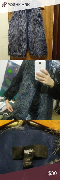 LuLuxurious Mossimo Blue Faux Fur Vest Luxurious blue faux fur vest. This vest is a size medium but can also fit a small without looking to big. It is in great condition, practically looks brand new, and has only been worn a couple of times. The fur on this vest is super soft and luscious. I've never had it feel itchy or uncomfertable. It also has a small metal clasp around the neck area if you wish to give the vest a closed or buttoned up appearance.   If you have any questions feel free to…