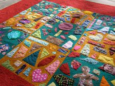 """New concept to me, called a """"tile quilt"""". The background fabric is the """"grout"""" and the applique pieces the tile. So many ideas on this one!"""