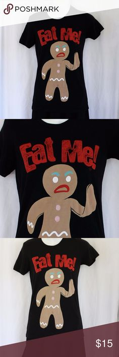 """Gingerbread Man Eat Me! Tee Ugly Christmas ❄️ Inappropriate Christmas tee Black with Red, White, Turquoise, Pink, & Brown Gingerbread Man flipping the bird Ironic small light stain (I've darkened it for this photo) in the crotch of the gingerbread man/woman - sort of goes along with what he or she is saying   Size: Small  16"""" Pit-to-Pit; 25"""" length  One of many cute and ugly Christmas Sweaters for your tacky event! Ugly Christmas Sweater Parties Christmas Pub Crawls Kitschy Festive Office…"""