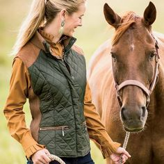 BackOverviewThis equestrian style Olive Green Quilted Vest With Suede looks right at home whether you are riding the range or strolling the city streets. It features two front zip pockets asymmetrical quilting and faux suede accents on sleeve holes yoke and back belt. S-XL. Imported.