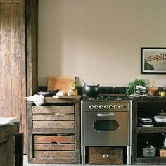 cabin kitchen. love the apple crate drawers.