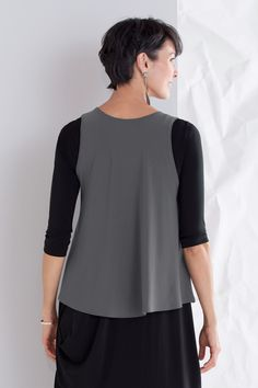 Crop Smock by Sympli . Layered over dresses or tunics, this top completely transforms your look with distinctive shaping and a splash of color. A deep scooped neckline pairs with crisscrossed layering in the front, while the back has full coverage.