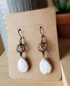 Hey, I found this really awesome Etsy listing at https://www.etsy.com/listing/585567945/antiqued-copper-and-white-howlite-drop