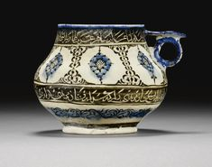 A Kashan Cup painted with medallions and inscriptions, Persia, early 13th century