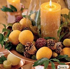 Winter Centerpiece idea- lemons, oranges, pine cones. Great with the sent of cinnamon, cloves (wassail). Let's get out of the cold.