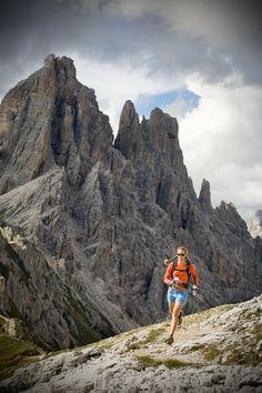 Woman running in the Italian Dolomites