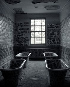 Abandoned state hospital... the writing's on the wall - the only way to express themselves
