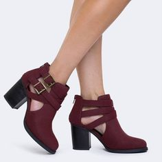 "Burgundy cut-out boots that make a ""look at me"" kind of statement wherever they…"