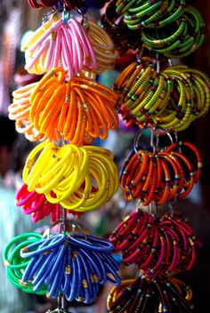always find these threaded bangles bursting out of makeshift stalls lining indian bazaars