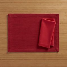 Grasscloth Ruby Placemat and Fete Ruby Cotton Napkin | Crate and Barrel
