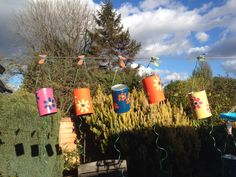 Bird Scarers - tin cans painted and decorated with enamel paint - buttons or something suitable threaded to hang inside the can to jingle