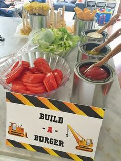 Build-a-Burger food station for a construction-themed birthday party. Empty paint cans with small paint brushes make a great way to serve and display condiments. See more photos, décor and DIY project details from this party at www.fabeveryday.com.