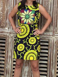 Vestido cconfeccionado con tela Saburete y mola en forma de flor.  Siguenos en instagram guairabyjt