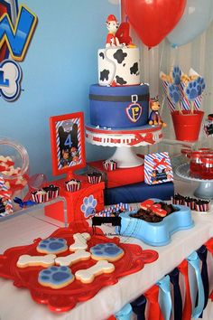Paw Patrol Party details to LOVE…. ♥ Amazing Paw Patrol themed birthday cake with Marshall cake topper ♥ Paw Patrol paw shaped cookie pops ♥ Paw Patrol themed cake pops ♥ Fun party backdrop w… Paw Patrol Birthday Decorations, Paw Patrol Birthday Cake, Puppy Birthday, Baby 1st Birthday, 4th Birthday Parties, Birthday Ideas, Bolo Do Paw Patrol, Paw Patrol Cake, Paw Patrol Party