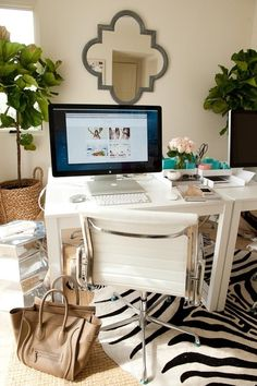 In love the mirror, chair and rug. ~Sarah   funky yet chic office space