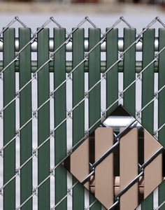 chain link fence decorative slats - I might try this with slats from mini blinds