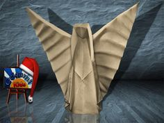 """Origami Nativity Angel by Max Hulme  Designer: Max Hulme  Variation """"Wings Up"""", Folder and Photographer: @Origami_Kids   How to fold :  How to fold : http://www.origamichristmas.com/2014/11/nativity-origami-angel-max-hulme.htm    Difficulty level: Medium Time to fold 45 min. 28 steps. Folded from one classic cream uncut square origami paper, about 25cm x 25cm."""