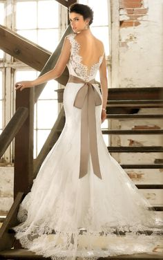 Beautiful wedding dress with lace train and satin bow.