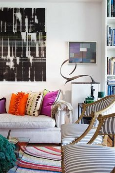 I like this. I'm a big fan of understated colorful living rooms